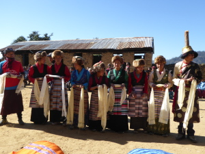 Parents and students from the school perform a welcoming Sherpa dance to thank NAFA for helping their community